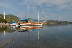 Old wooden sailing ship in the sea bay stock photography