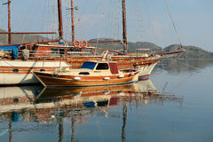 Old wooden sailing ship in the sea bay Royalty Free Stock Images