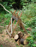Old Wooden Sawhorse in Forest Royalty Free Stock Photos