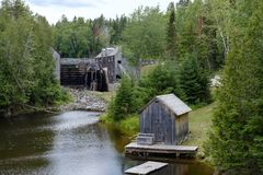 Old wooden sawmill on river. In historic settlement Kings Landing, New Brunswick, Canada stock photos