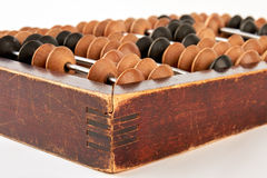 Old wooden scratched abacus. Stock Photo