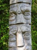 Old wooden sculpture - faces, Lithuania Royalty Free Stock Images