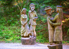 Old wooden sculptures in the forest. `Witch hill` park, Lithuania. JUODKRANTE, LITHUANIA - 18 JULY 2014: Old wooden sculptures in the forest. `Witch hill` park Royalty Free Stock Photos