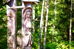 Old wooden sculptures in the forest. `Witch hill` park, Lithuania. JUODKRANTE, LITHUANIA - 18 JULY 2014: Old wooden sculptures in the forest. `Witch hill` park Royalty Free Stock Images