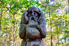 Old wooden sculptures in the forest. Witch Hill park, Lithuania. JUODKRANTE, LITHUANIA - 18 SEPTEMBER 2016: Old wooden sculptures in the forest. Witch Hill park Stock Photos