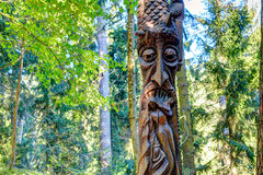 Old wooden sculptures in the forest. Witch Hill park, Lithuania. JUODKRANTE, LITHUANIA - 18 SEPTEMBER 2016: Old wooden sculptures in the forest. Witch Hill park Royalty Free Stock Photography