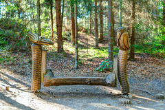 Old wooden sculptures in the forest. Witch Hill park, Lithuania. JUODKRANTE, LITHUANIA - 18 SEPTEMBER 2016: Old wooden sculptures in the forest. Witch Hill park Royalty Free Stock Photo