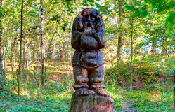 Old wooden sculptures in the forest. Witch Hill park, Lithuania. JUODKRANTE, LITHUANIA - 18 SEPTEMBER 2016: Old wooden sculptures in the forest. Witch Hill park Stock Image
