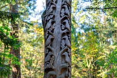 Old wooden sculptures in the forest. Witch Hill park, Lithuania. JUODKRANTE, LITHUANIA - 18 SEPTEMBER 2016: Old wooden sculptures in the forest. Witch Hill park Stock Photo