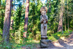 Old wooden sculptures in the forest. Witch Hill park, Lithuania. JUODKRANTE, LITHUANIA - 18 SEPTEMBER 2016: Old wooden sculptures in the forest. Witch Hill park Royalty Free Stock Image