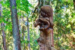 Old wooden sculptures in the forest. Witch Hill park, Lithuania. JUODKRANTE, LITHUANIA - 18 SEPTEMBER 2016: Old wooden sculptures in the forest. Witch Hill park Royalty Free Stock Photos