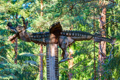Old wooden sculptures in the forest. Witch Hill park, Lithuania. JUODKRANTE, LITHUANIA - 18 SEPTEMBER 2016: Old wooden sculptures in the forest. Witch Hill park Royalty Free Stock Images
