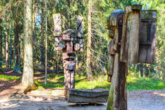 Old wooden sculptures in the forest. Witch Hill park, Lithuania. Royalty Free Stock Images