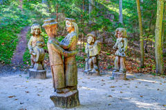 Old wooden sculptures in the forest. Witch Hill park, Lithuania. Stock Photography