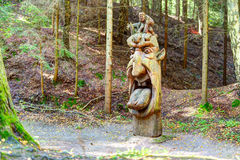 Old wooden sculptures in the forest. Witch Hill park, Lithuania. Stock Photo