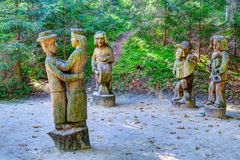 Old wooden sculptures in the forest. Witch Hill park, Lithuania. JUODKRANTE, LITHUANIA - 18 SEPTEMBER 2016: Old wooden sculptures in the forest. Witch Hill park Stock Images