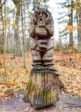 Old wooden sculptures in the forest. Witch Hill park lithuanian: Raganu kalnas. Juodkrante, Lithuania. JUODKRANTE, LITHUANIA - 13 NOVEMBER 2016: Old wooden Stock Image