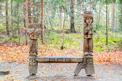 Old wooden sculptures in the forest. Witch Hill park lithuanian: Raganu kalnas. Juodkrante, Lithuania. JUODKRANTE, LITHUANIA - 13 NOVEMBER 2016: Old wooden Royalty Free Stock Photography