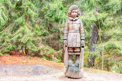 Old wooden sculptures in the forest. Witch Hill park lithuanian: Raganu kalnas. Juodkrante, Lithuania. JUODKRANTE, LITHUANIA - 13 NOVEMBER 2016: Old wooden Royalty Free Stock Photos