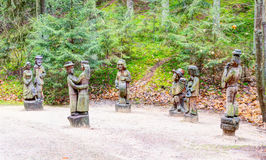 Old wooden sculptures in the forest. Witch Hill park lithuanian: Raganu kalnas. Juodkrante, Lithuania. JUODKRANTE, LITHUANIA - 13 NOVEMBER 2016: Old wooden Royalty Free Stock Images