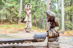 Old wooden sculptures in the forest. Witch Hill park lithuanian: Raganu kalnas. Juodkrante, Lithuania. JUODKRANTE, LITHUANIA - 13 NOVEMBER 2016: Old wooden Royalty Free Stock Photo
