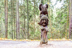 Old wooden sculptures in the forest. Witch Hill park lithuanian: Raganu kalnas. Juodkrante, Lithuania. JUODKRANTE, LITHUANIA - 13 NOVEMBER 2016: Old wooden Stock Images