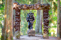 Old wooden sculptures in the forest. Witch Hill park lithuanian: Raganu kalnas. Juodkrante, Lithuania. JUODKRANTE, LITHUANIA - 13 NOVEMBER 2016: Old wooden Royalty Free Stock Image