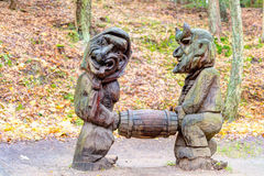 Old wooden sculptures in the forest. Witch Hill park lithuanian: Raganu kalnas. Juodkrante, Lithuania. JUODKRANTE, LITHUANIA - 13 NOVEMBER 2016: Old wooden Stock Photo