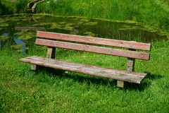 Old wooden seat bench in the garden Royalty Free Stock Image