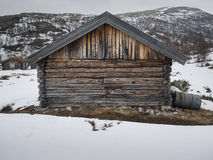 Old wooden shack in winter landscape Stock Photos