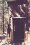 Old wooden shed in a forest Stock Images