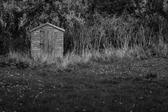 Old Wooden Shed on grassland old dry straw Stock Image