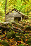 An old wooden shed is nestled away in the mountain Stock Images
