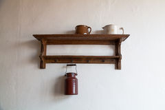 Old wooden shelf with milk jug. Royalty Free Stock Photos