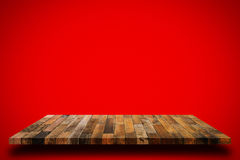 Old wooden shelf on red wall background. Empty old wooden shelf on red wall background. For display or montage your products stock image