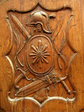 Old wooden shield. On the door of the historical building stock photos