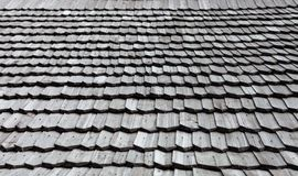 Old wooden shingle roof. Wooden surface texture Royalty Free Stock Images