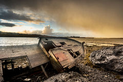 Old wooden ship on beach Royalty Free Stock Photos