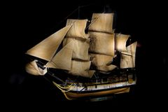 Wooden ship model. Light painting picture on black background. royalty free stock image