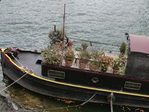 Old wooden ship in Paris with plants stock photography
