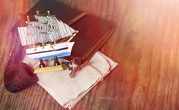 Old wooden ship with sails and masts toy on a stand. Vintage and. Retro toysr Royalty Free Stock Photos