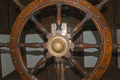 Old wooden ship wheel Stock Image