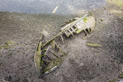 Old wooden ship wreck at the  lagoon Stock Photography