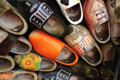 Old wooden shoes in Amsterdam. Very old wooden shoes wall in historical small dutch village Zaanse Schans Stock Image