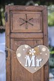 Old wooden shutter windows with hanging heart for Mr. Vintage decoration for weddings royalty free stock image