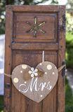 Old wooden shutter windows with hanging heart for Mrs. Vintage decoration for weddings royalty free stock image