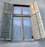Old wooden shuttered window in Sibiu, Transylvania, Romania. Wooden shutters on a mediaeval style house in Sibiu, European Capital of Culture in 2007 royalty free stock photos