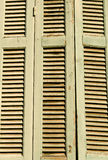 Old wooden shutters detail. From a Greek traditional house Royalty Free Stock Images