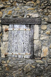 Old wooden shutters on stone wall background Stock Photography