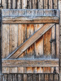 Old wooden shutters. On a wooden wall Royalty Free Stock Photos